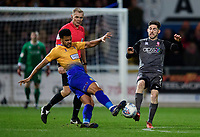Mansfield Town's Jacob Mellis vies for possession with Lincoln City's Tom Pett<br /> <br /> Photographer Chris Vaughan/CameraSport<br /> <br /> The EFL Sky Bet League Two - Mansfield Town v Lincoln City - Monday 18th March 2019 - Field Mill - Mansfield<br /> <br /> World Copyright © 2019 CameraSport. All rights reserved. 43 Linden Ave. Countesthorpe. Leicester. England. LE8 5PG - Tel: +44 (0) 116 277 4147 - admin@camerasport.com - www.camerasport.com