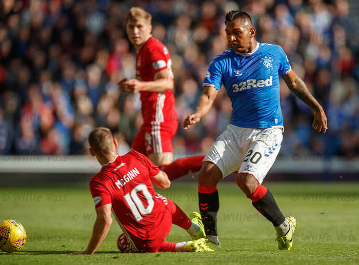 28.09.2018 Rangers v Aberdeen: Niall McGinn lunges in on Alfredo Morelos