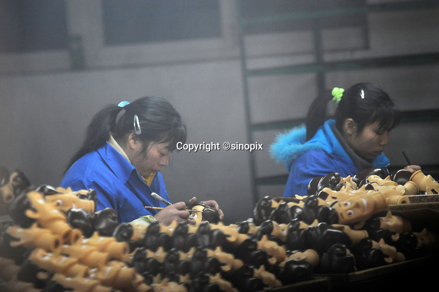 Workers in the moulding department at Shanghai Fashion Plastics that makes the &quot;Woody&quot; toy that features in the new Disney film Toy Story 3 that is going to be the biggest movie event of the year for children.<br />