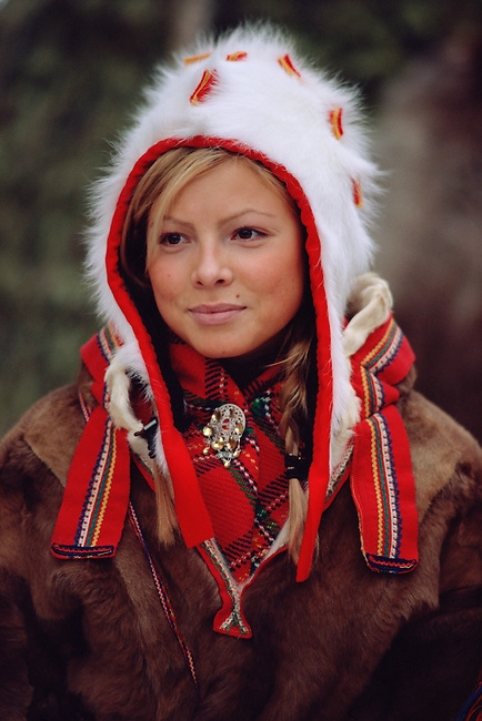 Portrait of pretty Sami girl in a traditional hat and peske at the Jokkmokk Winter Market. Sweden
