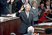 Washington, D.C. - October 6, 1994 -- President Nelson Mandela of South Africa acknowledges the applause as he addresses a Joint Session of the United States Congress  in Washington, DC on Thursday, October 6, 1994.  .Credit: Ron Sachs / CNP