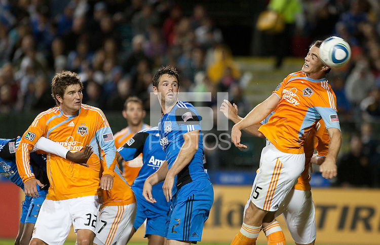 Cam Weaver heads the ball against Bobby Burling (2) and teammate Bobby Boswell (32). The Houston Dynamo defeated the San Jose Earthquakes 1-0 at Buck Shaw Stadium in Santa Clara, California on October 16th, 2010.