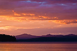 Sun setting on Lake Almanor, Canyon Dam, California.