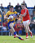 Kieran Malone of Clare in action against Gerard Mc Sorley of Louth during their national League game in Cusack Park. Photograph by John Kelly.