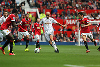 Pictured: Jonjo Shelvey of Swansea (C) against Ander Herrera. Saturday 16 August 2014<br /> Re: Premier League Manchester United v Swansea City FC at the Old Trafford, Manchester, UK.