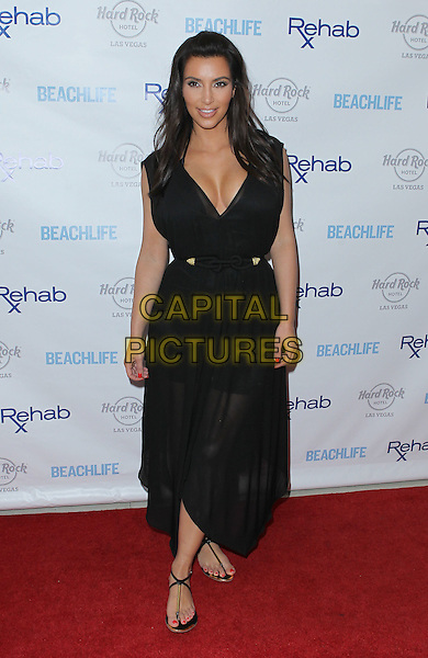 Kim Kardashian.hosts Rehab Sunday at Paradise Beach at the Hard Rock Hotel and Casino, Las Vegas, Nevada, USA..3rd June 2012 .full length black dress sheer cleavage belt  .CAP/ADM/MJT.© MJT/AdMedia/Capital Pictures.
