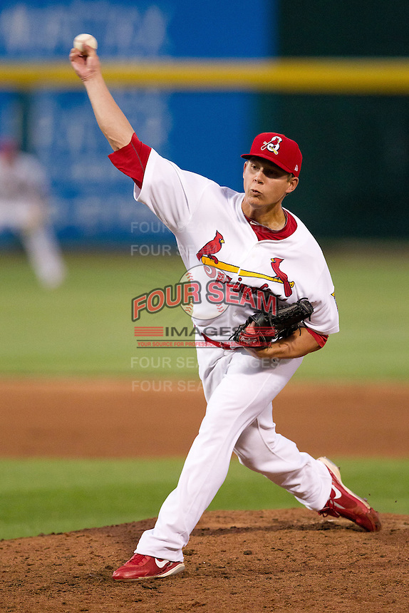 Kevin Thomas (11) of the Springfield Cardinals delivers a pitch during a game against the Arkansas Travelers at Hammons Field on June 13, 2012 in Springfield, Missouri. (David Welker/Four Seam Images)