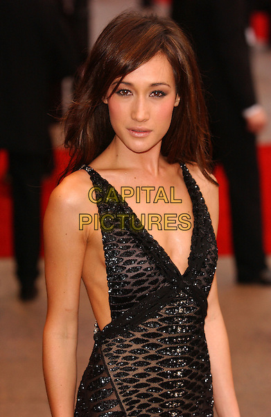 "MAGGIE Q.MAGGIE DENISE QUIGLEY.""Mission Impossible 3"" UK Film Premiere - Arrivals,.Odeon Leicester Square, London, England,.April 25th 2006.  .Mission: Impossible III half length  sheer dress black beaded .Ref: FIN.www.capitalpictures.com.sales@capitalpictures.com.©Steve Finn/Capital Pictures."
