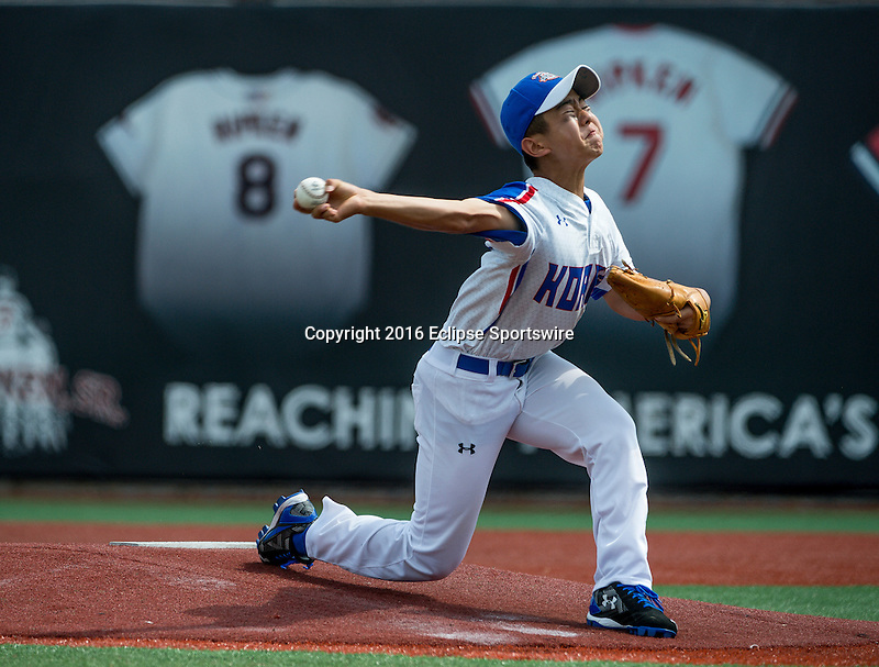 Aberdeen, MD - JULY 31: Youngwoon Kim #7 of Republic of Korea pitches during the game between the Republic of Korea and Mexico during the Cal Ripken World Series at The Ripken Experience Powered by Under Armour on July 31, 2016 in Aberdeen, Maryland. (Photo by Ripken Baseball/Eclipse Sportswire/Getty Images)
