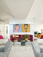 The luxurious penthouse apartment is full of edgy chic and sizzling colour. In the living room a pair of silk-screened prints by Andy Warhol hang above a 1960s Edward Wormley sofa upholstered in a Scalamandré velvet. The chairs in the foreground are by Charles Ramos, and the side table is by Achille Salvagni; the Louis XVI stools, circa 1780, are from Bernd Goeckler Antiques