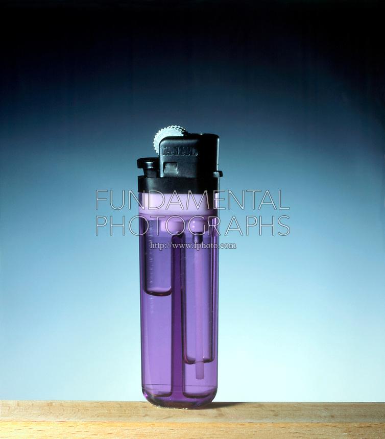 BUTANE LIGHTER<br /> (1 of 2)<br /> Butane Gas Escapes From Lighter<br /> Violet lighter is unlit
