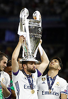 Calcio, Champions League: finale Juventus vs Real Madrid. Cardiff, Millennium Stadium, 3 giugno 2017.<br /> Real Madrid's Dani Carvajal holds up the trophy at the end of the Champions League final match between Juventus and Real Madrid at Cardiff's Millennium Stadium, Wales, June 3, 2017. Real Madrid won 4-1.<br /> UPDATE IMAGES PRESS/Isabella Bonotto
