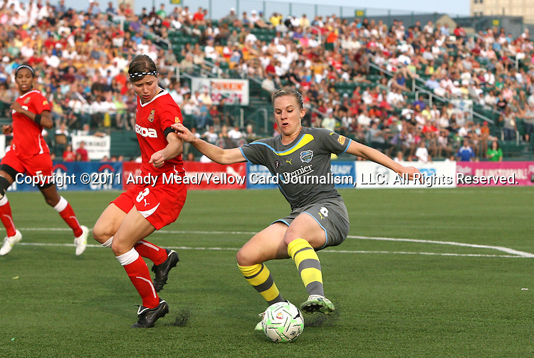 27 August 2011: Philadelphia's Amy Rodriguez (right) and Western New York's Rebecca Moros (left). Western New York Flash defeated the Philadelphia Independence 5-4 on penalty kicks to win the final after the game ended in a 1-1 tie after overtime at Sahlen's Stadium in Rochester, New York in the Women's Professional Soccer championship game.