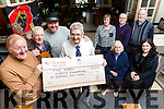 Michael Fox O'Connor and Members of the Bill Kirby Memorial Walk, on St Stephens Day, presented a Cheque €10,023 to Ted Moynihan of the Kerry Hospice Foundation on Monday. Pictured front l-r Michael 'Fox' O'Connor, Michael Gaffney, Mark Leen, Ted Moynihan. Back l-r Sis O'Connor, Siobhán Donnelly, Tralee Credit Union, Fiona Cotter, John Lynch, Frank Greaney,