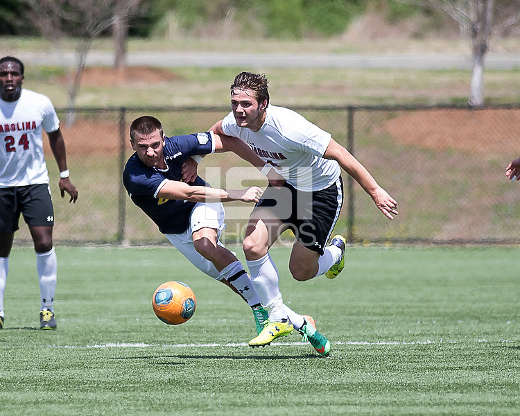 The UNC Greensboro Spartans played the University of South Carolina Gamecocks in The Manchester Cup on April 5, 2014.  The teams played to a 0-0 tie.  Lukas Zarges (7), Kurtis Turner (8)