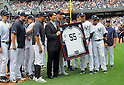 Hideki Matsui,<br /> JULY 28, 2013 - MLB :<br /> Hideki Matsui poses with a framed number 55 jersey and New York Yankees players after receiving it from Derek Jeter during his official retirement ceremony before the Major League Baseball game against the Tampa Bay Rays at Yankee Stadium in The Bronx, New York, United States. (Photo by AFLO)