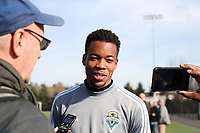 TUKWILA, WA - NOVEMBER 08: Jordy Delem #21 of the Seattle Sounders FC talks with reporter Michael Lewis at Starfire Sports Complex on November 08, 2019 in Tukwila, Washington.