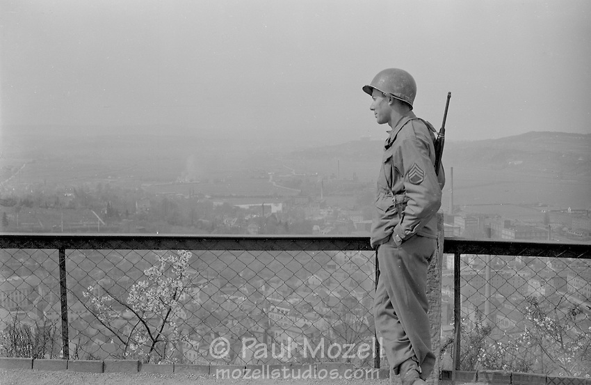 Al Mozell, looking down at a German town. circa April 1945