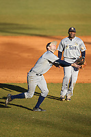Rice Owls third baseman Grayson Lewis (22) catches a pop fly behind the mound during the game against the Charlotte 49ers at Hayes Stadium on March 6, 2015 in Charlotte, North Carolina.  The Owls defeated the 49ers 4-2.  (Brian Westerholt/Four Seam Images)