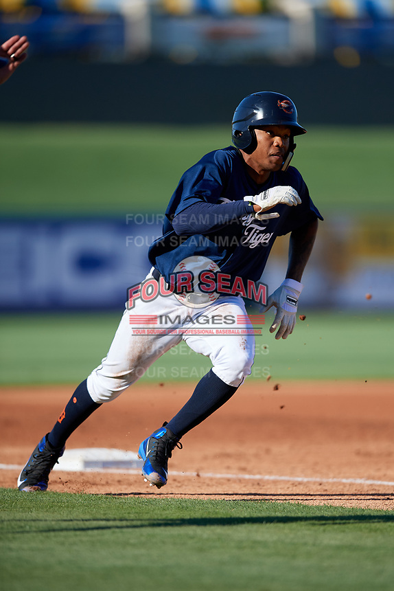 Lakeland Flying Tigers right fielder Jose Azocar (52) rounds third base during the first game of a doubleheader against the Bradenton Marauders on April 11, 2018 at Publix Field at Joker Marchant Stadium in Lakeland, Florida.  Lakeland defeated Bradenton 5-4.  (Mike Janes/Four Seam Images)