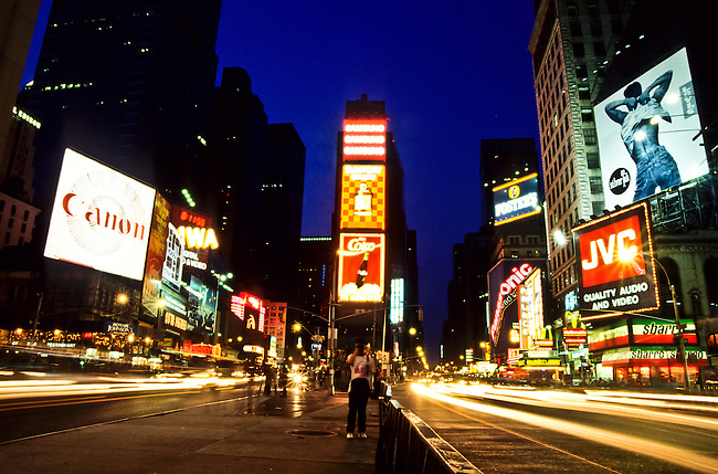 Time Square with neon lights at twilight in New York City, USA