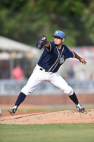 Asheville Tourists starting pitcher Helms Rodriguez (33) delivers a pitch during a game against the Rome Braves on May 16, 2015 in Asheville, North Carolina. The Braves defeated the Tourists 6-3. (Tony Farlow/Four Seam Images)