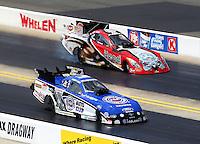 Sep 15, 2013; Charlotte, NC, USA; NHRA funny car driver Robert Hight (near) against Chad Head during the Carolina Nationals at zMax Dragway. Mandatory Credit: Mark J. Rebilas-
