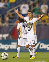 Pumas UNAM forward Juan Carlos Cacho (11) gestures towards assistant referee after an offside call. The New England Revolution defeated Pumas UNAM in SuperLiga group play, 1-0, at Gillette Stadium on July 14, 2010.