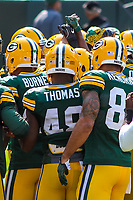 Green Bay Packers players huddle during a National Football League game against the Seattle Seahawks on September 10, 2017 at Lambeau Field in Green Bay, Wisconsin. Green Bay defeated Seattle 17-9. (Brad Krause/Krause Sports Photography)