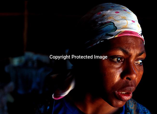 disiaids00268  Social Issues, Aids: Health. Nozuko Dlala, age 29, and infected by Aids, in her shack in Khayelitsha, South Africa. One of her four children are also infected. Depression.©Per-Anders Pettersson/iAfrika Photos