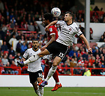 Jake Wright of Sheffield Utd and Liam Birdcutt of Nottingham Forest during the Championship match at the City Ground Stadium, Nottingham. Picture date 30th September 2017. Picture credit should read: Simon Bellis/Sportimage