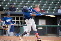 Tulsa Drillers infielder Christian Santana (23) connects on a pitch on May 13, 2019, at Arvest Ballpark in Springdale, Arkansas. (Jason Ivester/Four Seam Images)