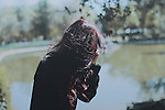 outdoors portrait of a girl hiding her face