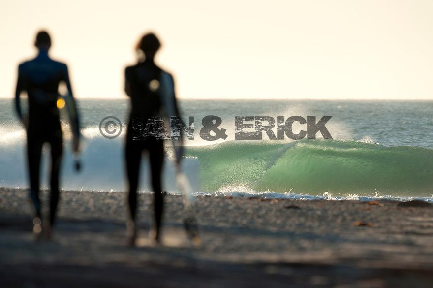 Surfers at Jake Pt in Kalbarri, Western Australia.