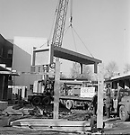 Pittsburgh PA: View of workers from the Cemensteel Company preparing to work on the new Homewood Elementary School.<br /> The unique product consisted of prefabricated steel and concrete that was delivered to a job site for  a more streamlined construction of a building.<br /> Not sure how well it worked, the company was incorporated in 1958 but was out of business in 1963.