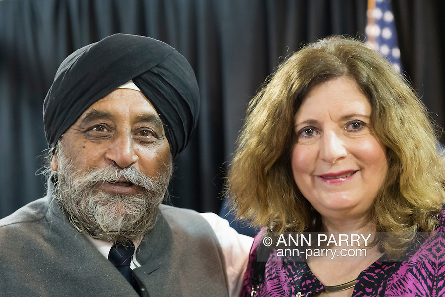 MOHINDER SINGH TANEJA of Salisbury, a Sikh and Indian community advocate, and MARIA BRENNAN of Wantagh, pose for a photo at Press Conference supporting extension of the NY Property Tax Cap. Earlier, Brennan introduced the Governor after she spoke to audience about how, prior to the tax cap, her taxes increased 10% in one year, and how high taxes are a concern to family members she'd like to join her in Long Island. At the bi-partisan event at Knights of Columbus Hall, over a hundred area residents and officials, and the governor, urged extending the property tax cap before the state legislative session ends on June 17. The NY Property Tax Cap is set to expire June 2016, but is legally linked to NYC rent-control regulations set to expire this month.