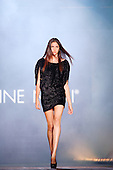 A model walks down the runway wearing a short black dress at the Roxanne Nikki fall fashion show during the Fashion & design festival in Montreal.