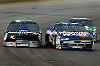 LONG POND, PA - JUNE 16: Dale Earnhardt (#3) runs into Sterling Marlin (#22) during the Champion Spark Plug 500 on June 16, 1991, at the Pocono International Raceway near Long Pond, Pennsylvania.