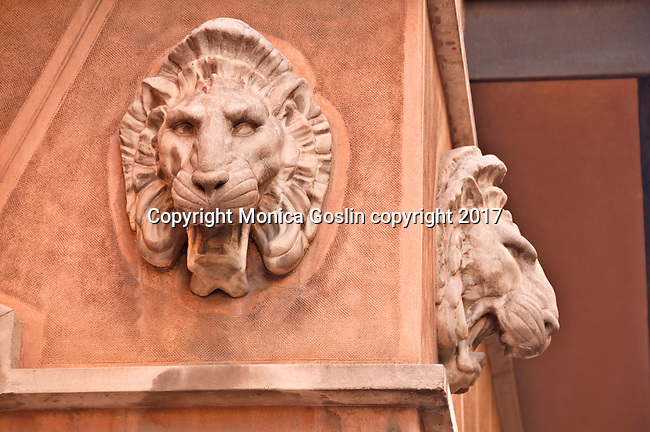 Stone lions on a street corner in the old city center in Madrid, Spain