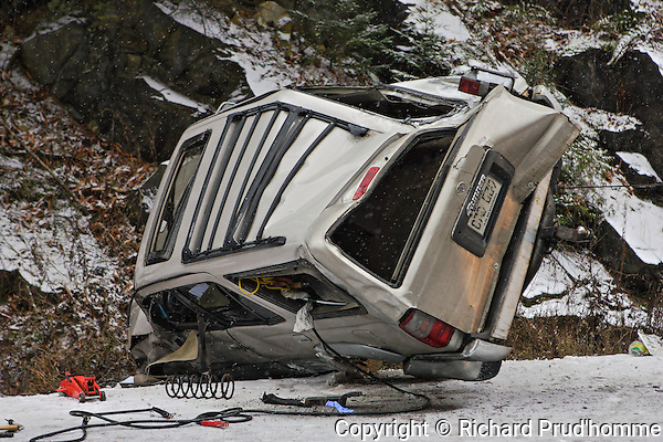 An SUV loses control on a slippery snow covered road.