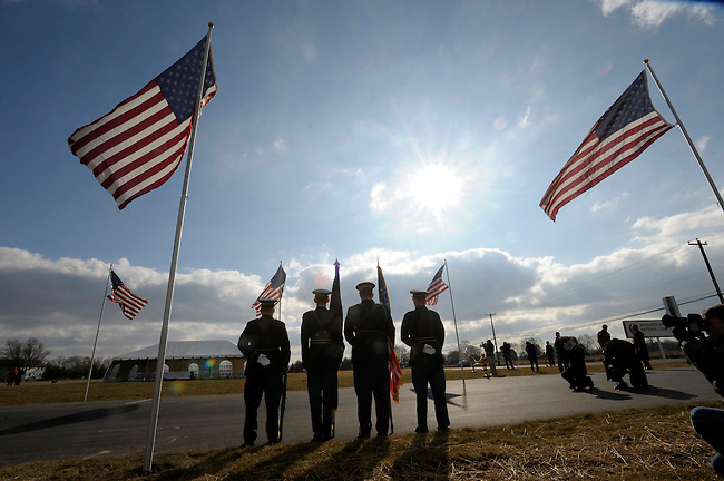 A Military Honor Guard stands at attention during the first burials of American servicemen at the new Washington Crossing National Cemetery Wednesday, Jan. 20, 2010 in Newtown, Pa. (AP Photo/Bradley C Bower)