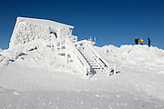 The Tip Top House (originally built as a hotel in 1853) on the summit of Mount Washington in the White Mountains, New Hampshire during the winter months. Mount Washington, at 6,288 feet, is the tallest mountain in the northeastern United States.