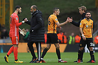 Wolverhampton Wanderers Manager Nuno Espirito Santo with Rui Patrício of Wolverhampton Wanderers and Graham Potter Head Coach of Brighton & Hove Albion with Conor Coady of Wolverhampton Wanderers and João Moutinho of Wolverhampton Wanderers at the end of the game. during Wolverhampton Wanderers vs Brighton & Hove Albion, Premier League Football at Molineux on 7th March 2020