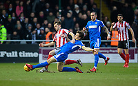 Lincoln City's Lee Frecklington vies for possession with Notts County's Matty Virtue<br /> <br /> Photographer Chris Vaughan/CameraSport<br /> <br /> The EFL Sky Bet League Two - Lincoln City v Notts County - Saturday 13th January 2018 - Sincil Bank - Lincoln<br /> <br /> World Copyright &copy; 2018 CameraSport. All rights reserved. 43 Linden Ave. Countesthorpe. Leicester. England. LE8 5PG - Tel: +44 (0) 116 277 4147 - admin@camerasport.com - www.camerasport.com