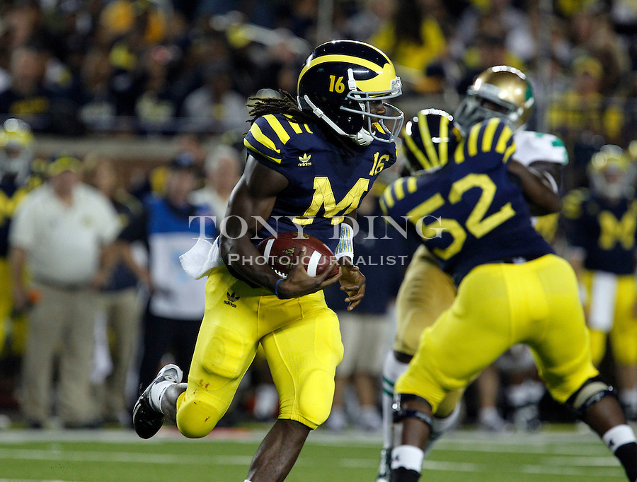Michigan quarterback Denard Robinson (16) rushes in the second quarter of an NCAA college football game, Saturday, Sept. 10, 2011, in Ann Arbor, Mich. (AP Photo/Tony Ding)