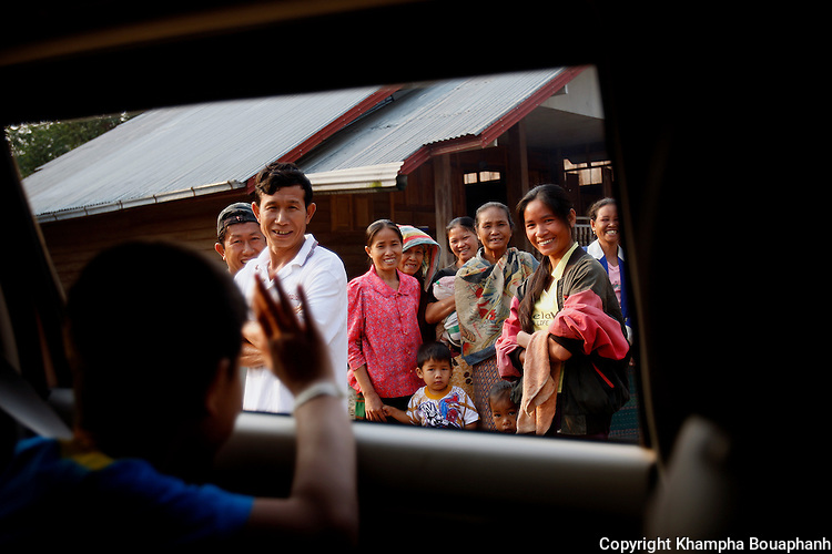 Joi Tipphavong waves to family and friends as he leave his home at Ban Khe to study in Vientiane on Saturday, March 8, 2008.  (Star-Telegram/Khampha Bouaphanh).**NO SALES, NO MAGS**