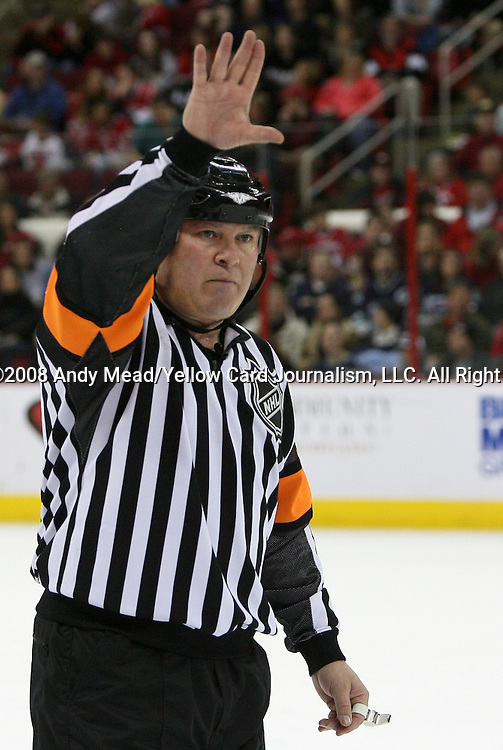 26 February 2008: Referee Mick McGeough. The Carolina Hurricanes defeated the New Jersey Devils 2-1 after overtime at the RBC Center in Raleigh, NC in a 2007-08 National Hockey League regular season game.