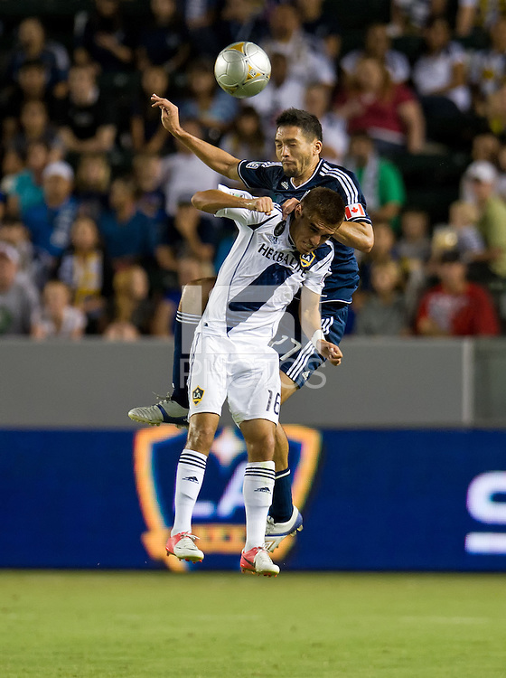 CARSON, CA - September 1, 2012: Vancouver midfielder Jun Davidson (27) and LA Galaxy midfielder Hector Jimenez (16) during the LA Galaxy vs the Vancouver Whitecaps FC at the Home Depot Center in Carson, California. Final score LA Galaxy 2, Vancouver Whitecaps FC 0.