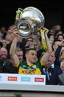 Peter Crowley lifts the Sam Maguire Cup to celebrate  Kerry's victory over Donegal in the All-Ireland Football Final against  in Croke Park 2014.<br /> Photo: Don MacMonagle<br /> <br /> <br /> Photo: Don MacMonagle <br /> e: info@macmonagle.com