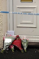 """Pictured: Flowers and a cuddly toy left on the threshold of the family home in Pontyberem, Carmarthenshire, west Wales. Wednesday 19 February 2014 <br /> Re: The parents of a six-day-old baby who died at a house in Carmarthenshire where a dog was later seized have paid tribute to a """"dearly loved daughter"""".<br /> Eliza-Mae Mullane from Pontyberem was flown to hospital in Cardiff on Tuesday but doctors were unable to save her.<br /> Her parents Sharon John and Patrick Mullane, said they would cherish the short time they had with her, adding """"she will always be in our hearts.""""<br /> The family's pet Alaskan Malamute Nisha has been seized by police.<br /> The tribute continued: """"Even though she was an important part of our family for such a short period of time, Eliza-Mae will always be in our hearts and thoughts and we will cherish the little time we were able to share with her.<br /> """"She was a dearly loved daughter, sister, grand-daughter and niece."""